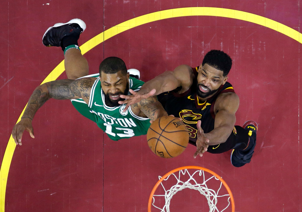 . Cleveland Cavaliers\' Tristan Thompson, right, and Boston Celtics\' Marcus Morris reach for a rebound in the second half of Game 3 of the NBA basketball Eastern Conference finals Saturday, May 19, 2018, in Cleveland. The Cavaliers won 116-86. (AP Photo/Tony Dejak)