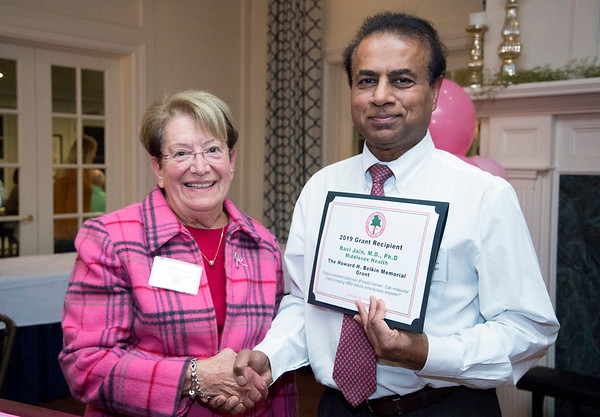 10/10/19 Wesley Bunnell | StaffrrThe CT Breast Health Initiative held their award dinner at Shuttle Meadow Country Club to honor their donors. Louise Belkin from the CT BHI presents Ravi Jain, M.D. , P.H.D. from Middlesex Health with the Howard H. Belkin Memorial Grant which is named in honor of her late husband.