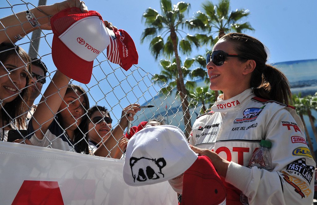 . 4/19/13 - Kate del Castillo signs autographs after the Friday morning practice of the Toyota Pro/Celebrity race at the 39th Annual Toyota Grand Prix of Long Beach. Photo by Brittany Murray / Staff Photographer