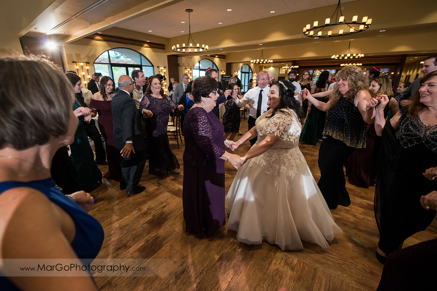 jewish bride and groom's mother during horah dance at Livermore Garre Vineyard and Winery