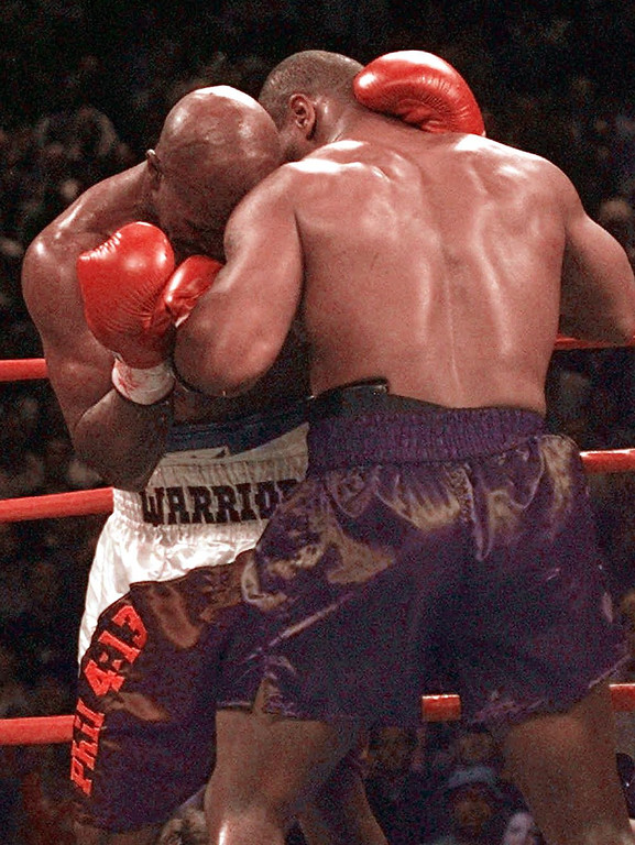 . Mike Tyson, right, bites Evander Holyfield on the left ear in the third round of their WBA Heavyweight match Saturday, June 28, 1997, at the MGM Grand in Las Vegas. Holyfield retained his title. (AP Photo/Lenny Ignelzi)