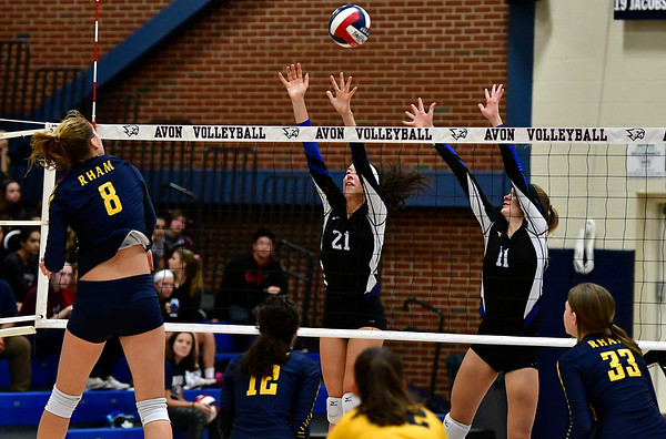 11/1/2018 Mike Orazzi | Staff Bristol Eastern's Aliana Rivoira (21) and Ryley Plourde (11) with RHAM's Kaylin Hadley (8) during the CCC Volleyball Tournament at Avon High School Thursday night.