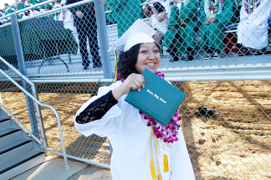 ". Daisy Burgos receives her diploma in ""Highest Honors,\"" during Schurr High School 2013 Commencement Exercises, at Ken Davis Field, at Schurr High School in Montebello, Thursday, June 20, 2013. (Correspondent Photo by James Carbone/SWCITY)"