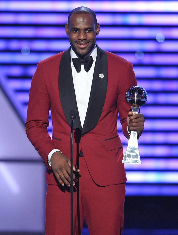 . LeBron James accepts the award for best male athlete at the ESPY Awards on Wednesday, July 17, 2013, at Nokia Theater in Los Angeles. (Photo by John Shearer/Invision/AP)
