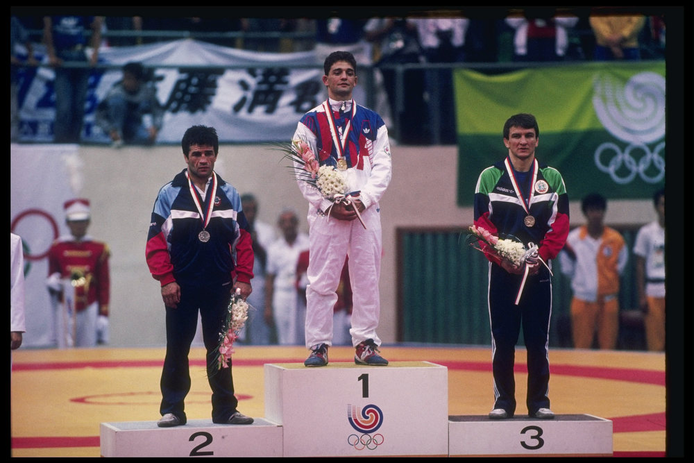 Description of . 29 Sep 1988: John Smith of the United States (center) stands with Stepan Tarkissian of the Soviet Union (left) and Simeon Chterev of Bulgaria after being awarded medals in the 62 kg final during the Summer Olympics in Seoul, South Korea. (David Cannon/The Denver Post)