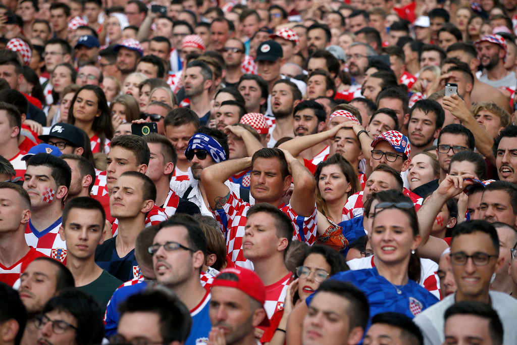 . Croatia soccer fans react as they watch a television broadcast of the Russia 2018 World Cup match between France and Croatia in downtown Zagreb, Croatia, Sunday, July 15, 2018. (AP Photo/Darko Vojinovic)