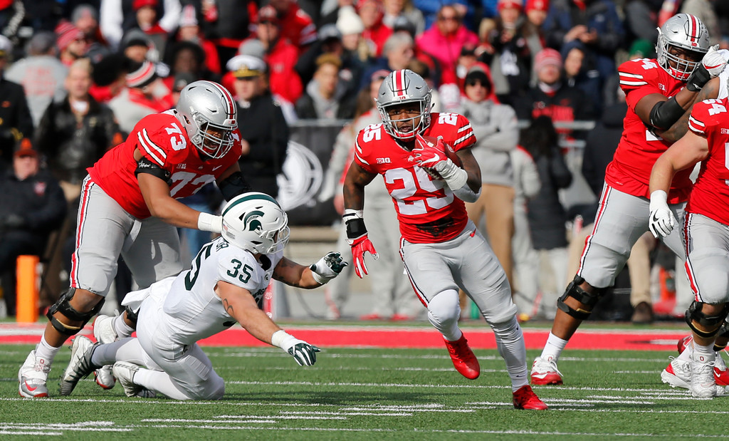 . Ohio State running back Mike Weber, right, runs past Michigan State linebacker Joe Bachie during the first half of an NCAA college football game Saturday, Nov. 11, 2017, in Columbus, Ohio. (AP Photo/Jay LaPrete)