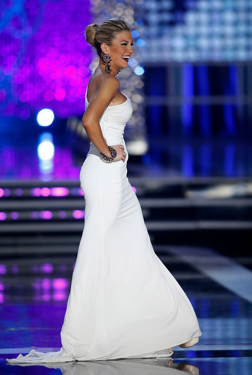 . Miss New York Mallory Hytes Hagan competes in the evening gown portion of the Miss America 2013 pageant on Saturday, Jan. 12, 2013, in Las Vegas. Hytes Hagan was later crowned Miss America 2013. (AP Photo/Isaac Brekken)