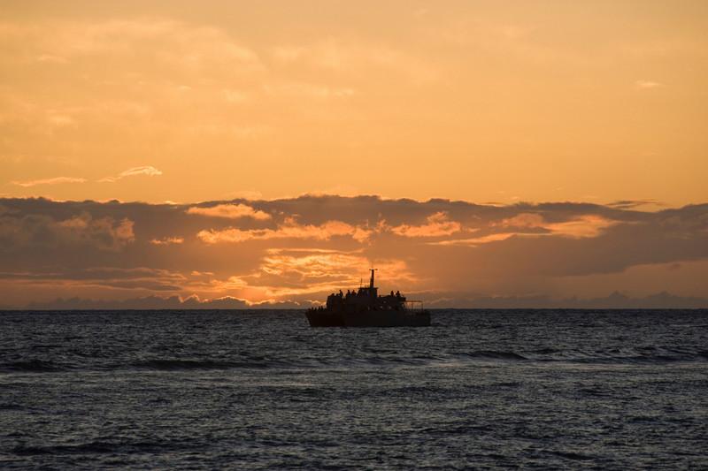 Boat off lahaina at sunset
