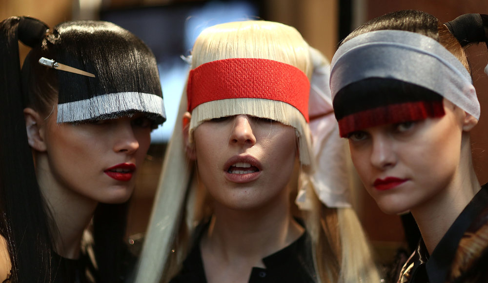 Description of . Models backstage at the Belle Sauvage show during London Fashion Week Fall/Winter 2013/14 at Freemasons Hall on February 15, 2013 in London, England.  (Photo by Tim Whitby/Getty Images)