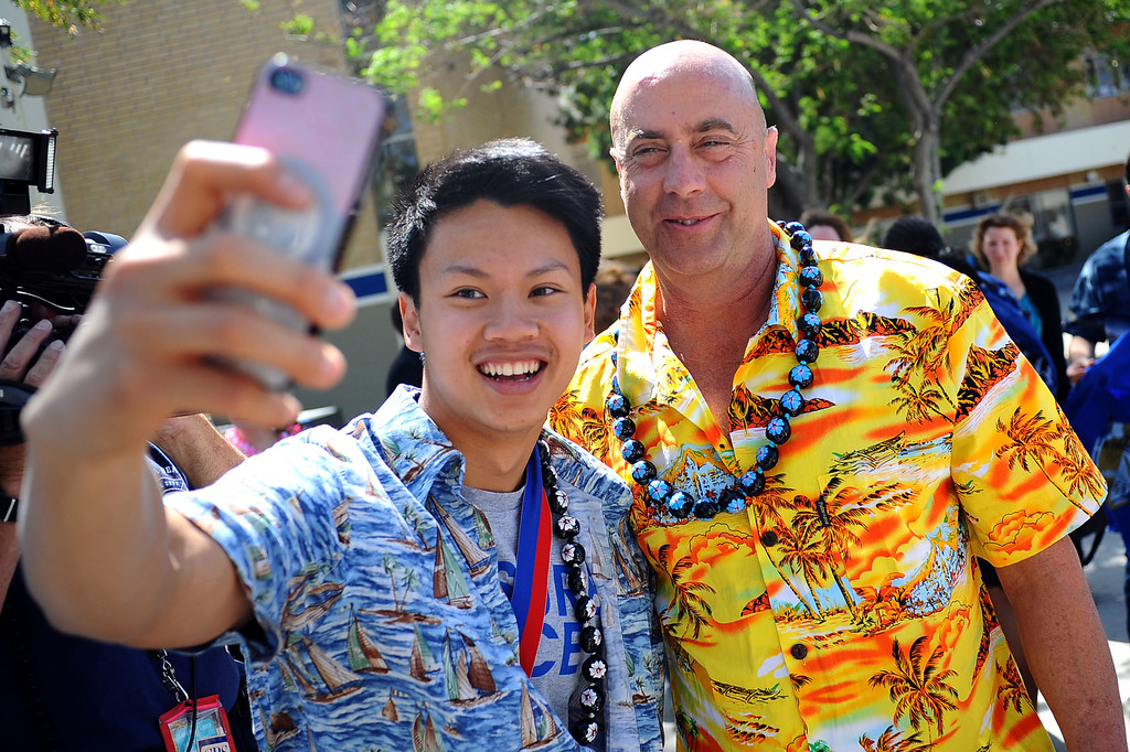 . Justin Chau poses for a photo with school principal David P. Fehte following a rally for El Camino Real Charter High School\'s Academic Decathlon team May 1, 2014.(Andy Holzman/Los Angeles Daily News)