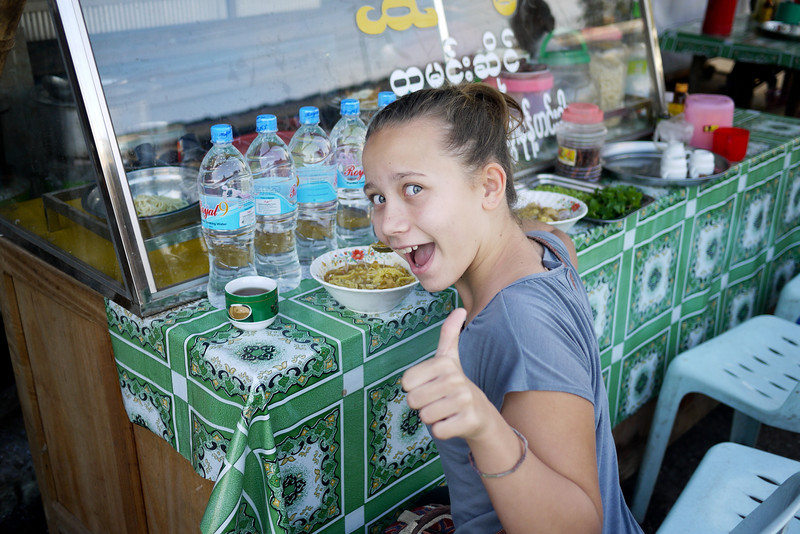 Ana is all smiles with her soup in Hpa-An, Burma.