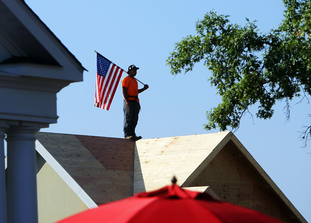 ". A worker waits for passing walkers during the 21-mile ""March to the Arch\"" memorial walk on Wednesday, Sept. 11, 2013, in Chesterfield, Mo. Wednesday marked the 12th anniversary of the 9/11 terrorist attacks.. (AP Photo/St. Louis Post-Dispatch, Erik M. Lunsford)"
