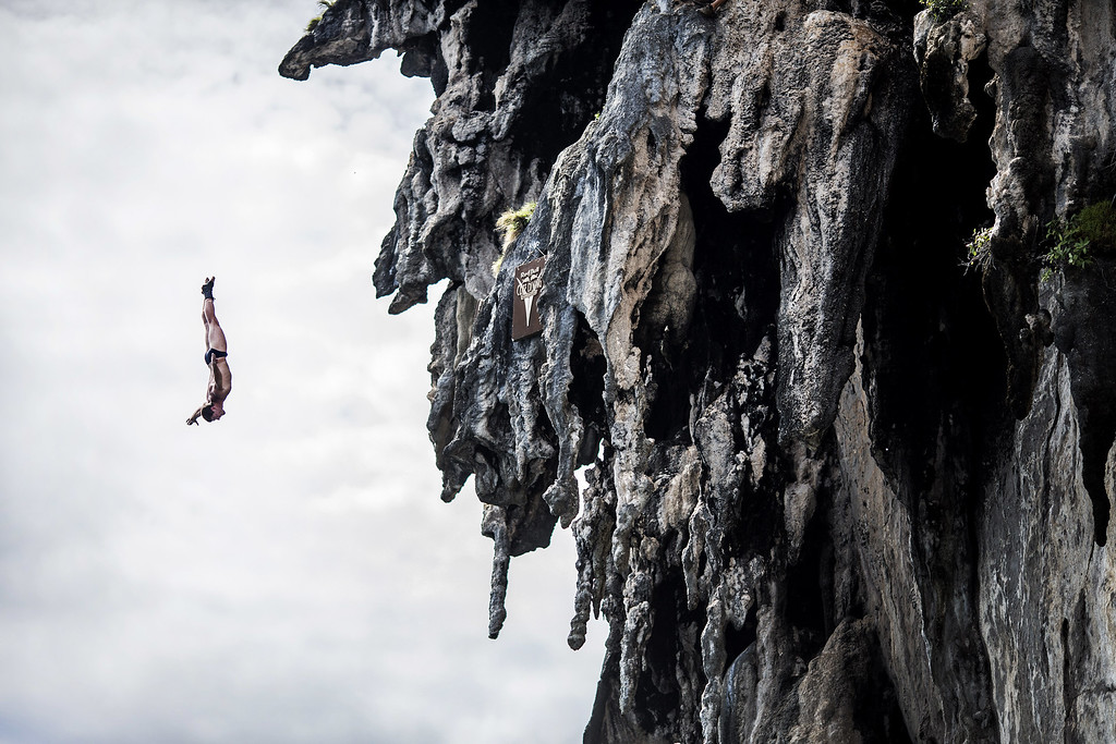 . In this handout image provided by Red Bull, David Colturi of the USA dives from a 25 meter rock at Viking Caves in the Andaman Sea during competition on the fifth day of the final stop of the 2013 Red Bull Cliff Diving World Series on October 24, 2013 at Phi Phi Island, Thailand. (Photo by Dean Treml/Red Bull via Getty Images)