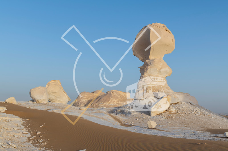 White limestone structures with low sunlight and ripples sand at the White desert national park