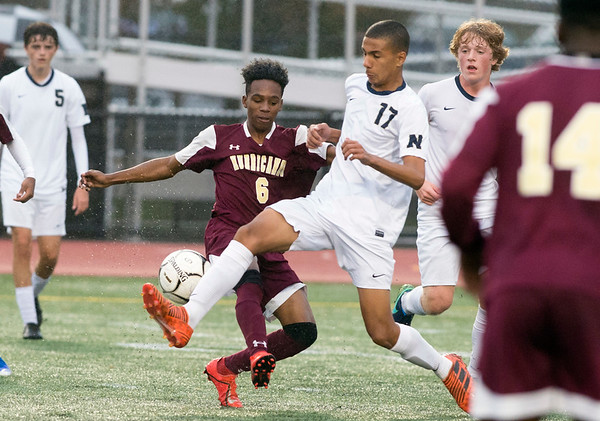 10/29/19 Wesley Bunnell | StaffrrNew Britain soccer was defeated 2-0 by Newington during a drizzle at Veterans Stadium on Tuesday afternoon. New Britain's Andwel Salmon (6) and Newington's Youseff Khadrani (17).