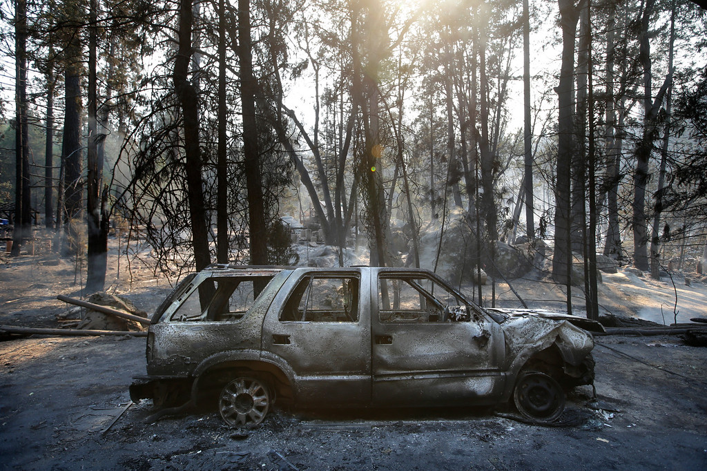 . A burned SUV sits in front of a campground destroyed by the Rim Fire near Yosemite National Park, Calif., on Monday, Aug. 26, 2013. Crews working to contain one of California\'s largest-ever wildfires gained some ground Monday against the flames threatening San Francisco\'s water supply, several towns near Yosemite National Park and historic giant sequoias. (AP Photo/Jae C. Hong)