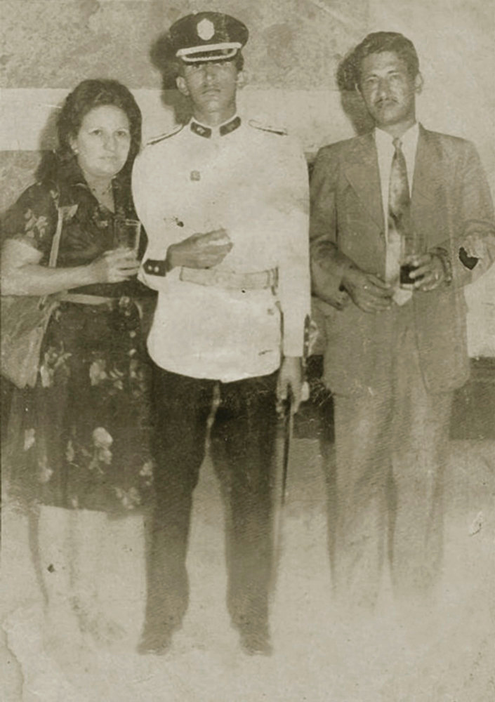 . Venezuela\'s President Hugo Chavez is pictured during his Military Academy years with his parents Elena and Hugo, in this undated handout photo provided by Venezuela\'s Ministry of Information and Communication. REUTERS/Ministry of Information and Communication/Handout