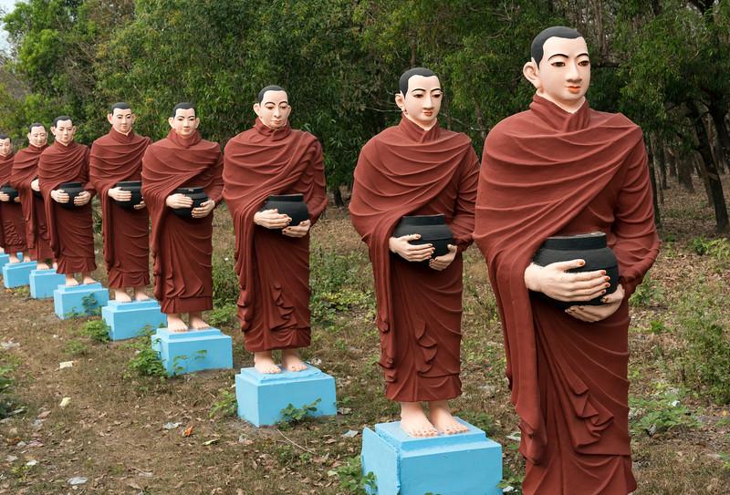 Row of statues of 500 Arahant disciples of Buddha at Win Sein, Mudon near Mawlamyine, Mon State, Burma - Myanmar