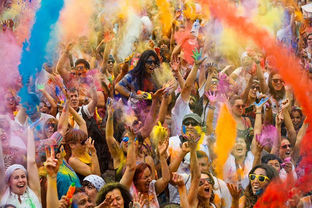 . Revelers of the Holi Festival of Colors throw colored powders in the air in Madrid, Spain, Saturday, Aug. 9, 2014. The festival is fashioned after the Hindu spring festival Holi, which is mainly celebrated in the north and east areas of India. (AP Photo/Daniel Ochoa de Olza)