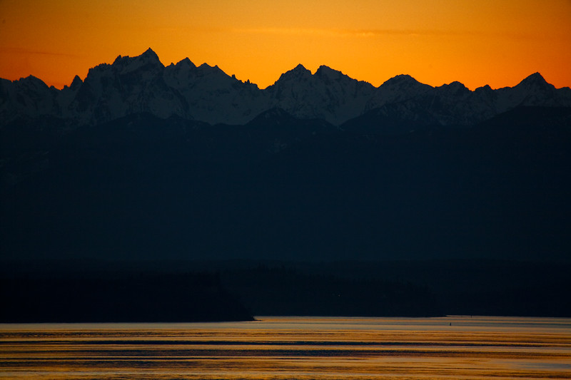 View toward Olympic Mountain in Washington State from across the Puget Sound just after Sunset