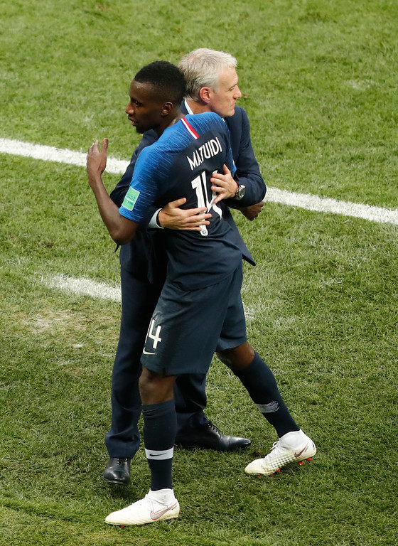 . France head coach Didier Deschamps hugs with France\'s Blaise Matuidi during the final match between France and Croatia at the 2018 soccer World Cup in the Luzhniki Stadium in Moscow, Russia, Sunday, July 15, 2018. (AP Photo/Frank Augstein)