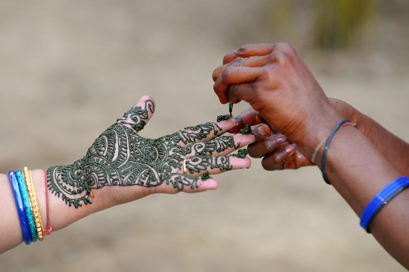 Process of applying mehendi (sort of temporary tatoo) on the hands of ladies at Surajkund Mela. Suraj Kund Mela 2009 held in Haryana (outskirts of Delhi), North India. The Suraj Kund Mela is an annual fair held near Delhi. Folk dances, handicrafts and a lot of fun.