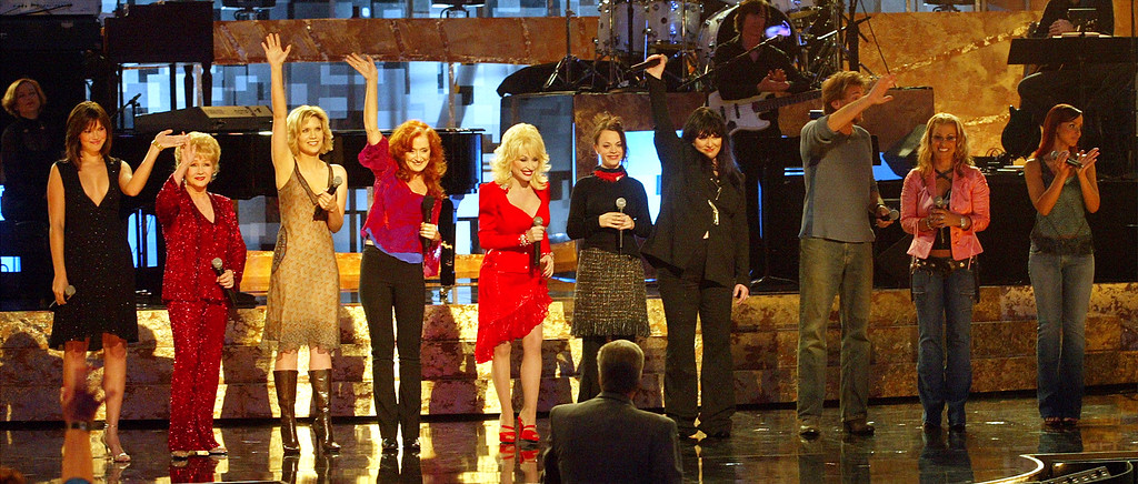. (L-R) Singers Mandy Moore, Debbie Reynolds, Alison Krauss, Bonnie Raitt, Dolly Parton, Mindy Smith, Ann Wilson, Kenny Logans, Anastacia and Mya perform on stage during the WOMEN ROCK! Songs from the Movies, the fourth annual concert for the fight against breast cancer, at the Kodak Theatre September 30, 2003 in Hollywood, California.  (Photo by Kevin Winter/Getty Images)