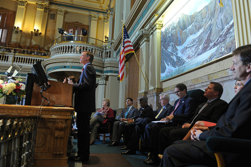 ". Governor John Hickenlooper gave his third State of the State address before a packed audience in the House Chambers of the State Capitol on January 10th, 2013.  The Governor took on the issue of gun regulations in his State of the State speech  calling for universal background checks for all gun purchases. In his third such address to the legislature, Hickenlooper, a Democrat, also called for a moment of silence in the House chamber to remember the victims of the Aurora shooting massacre and said Coloradans ""have an obligation to prevent similar tragedies.\"" The mayor, police chief and fire chief of Aurora were present for the governor\'s annual address.  -  Helen H. Richardson, The Denver Post"
