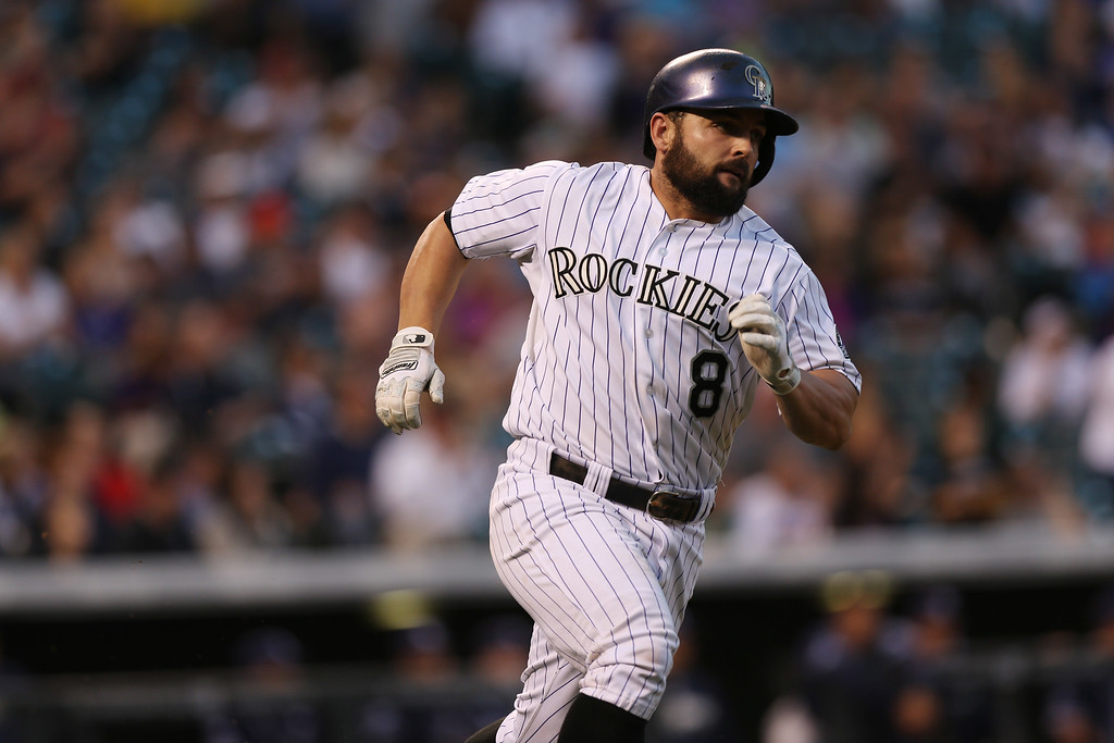 . Colorado Rockies\' Michael McKenry legs out his RBI-single against the San Diego Padres in the third inning of a baseball game in Denver on Saturday, Sept. 6, 2014. (AP Photo/David Zalubowski)