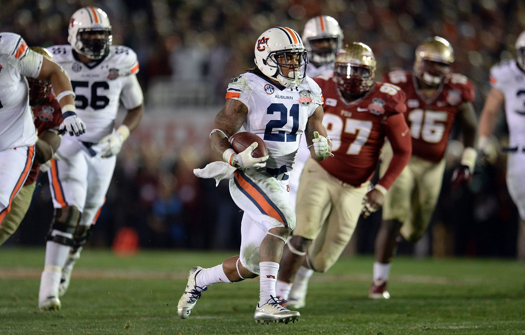 . Auburn running back Tre Mason (21) runs for a touchdown against Florida State in the fourth quarter of the BCS National Championship game at the Rose Bowl in Pasadena, Calif., on Monday, Jan. 6, 2014. Florida State won 34-31.