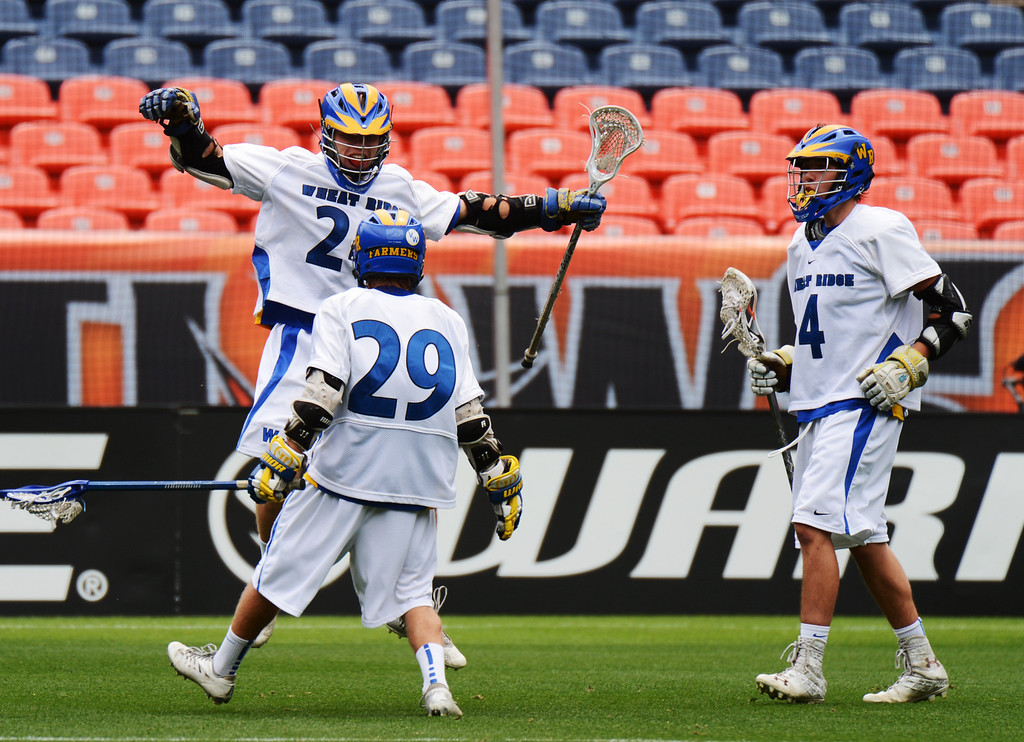 . DENVER, CO. - MAY 18 : Josh Kaufling of Wheat Ridge High School (24) celebrates his scoring with John Roach (29) by Tyler Knott (4) during 4A Boy\'s Lacrosse Championship game against Air Academy High School at Sports Authority Field at Mile High Stadium. Denver, Colorado. May 18, 2013. (Photo By Hyoung Chang/The Denver Post)