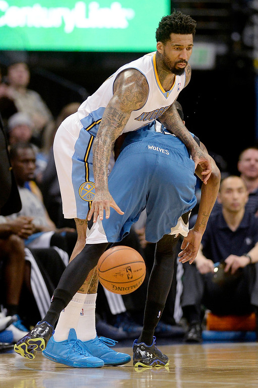 . Wilson Chandler (21) of the Denver Nuggets dribbles around Corey Brewer (13) of the Minnesota Timberwolves during the second half. (Photo By AAron Ontiveroz/The Denver Post)