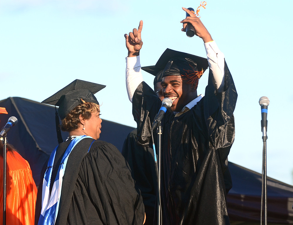 . Robert Carter celebrates while walking across the stage during Chester High School\'s graduation ceremony, Friday. (Times Staff / JULIA WILKINSON)
