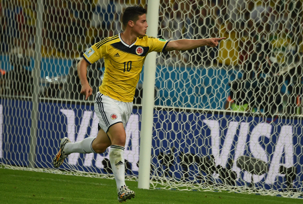 . Colombia\'s midfielder James Rodriguez celebrates scoring the 2-0 goal during the Round of 16 football match between Colombia and Uruguay at the Maracana Stadium in Rio de Janeiro during the 2014 FIFA World Cup in Brazil on June 28, 2014. LUIS ACOSTA/AFP/Getty Images