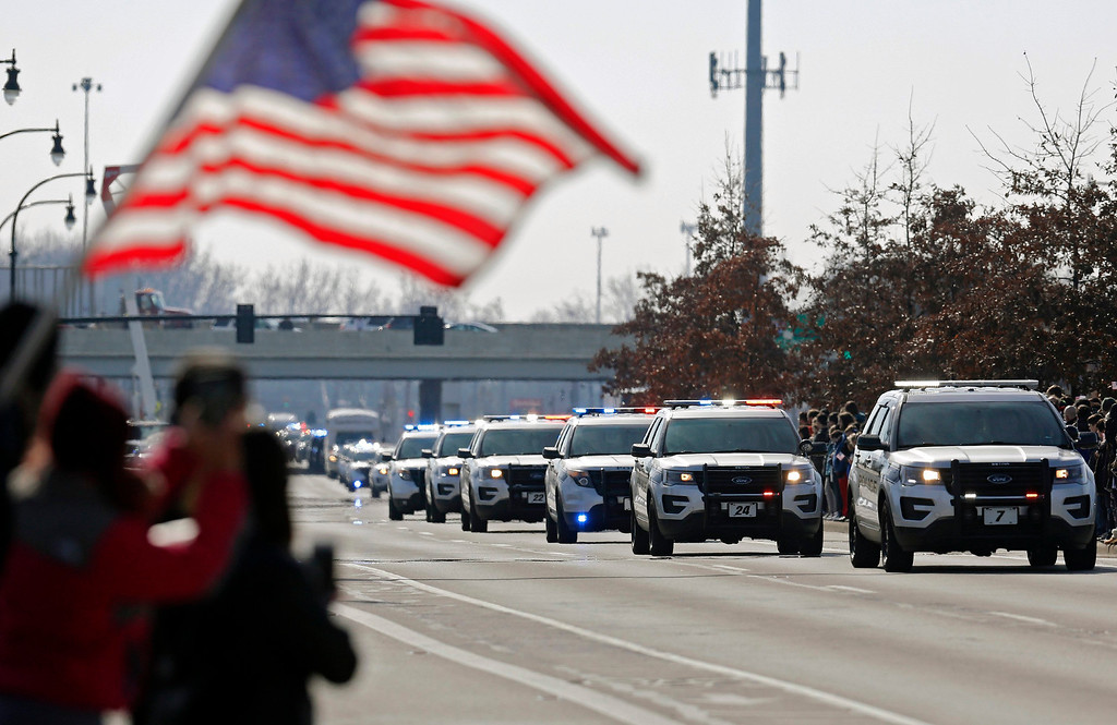 . The Police escort of Westerville Police officers Morelli and Joering home from Franklin County Coroners office today as they head north of S. State Street in Westerville, Ohio, Monday, Feb. 12, 2018. (Adam Cairns/The Columbus Dispatch via AP)