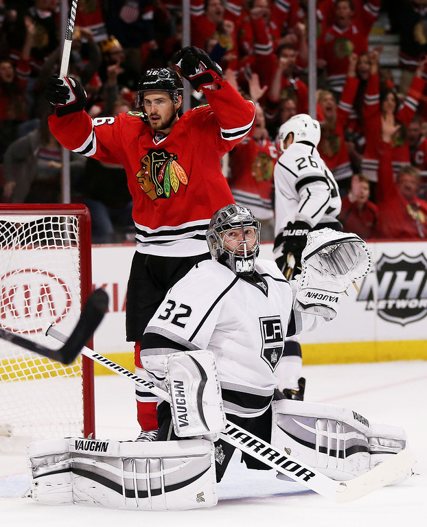 . Marcus Kruger #16 of the Chicago Blackhawks celebrates their second period goal as Jonathan Quick #32 of the Los Angeles Kings reacts in Game One of the Western Conference Final during the 2014 Stanley Cup Playoffs at United Center on May 18, 2014 in Chicago, Illinois.  (Photo by Jonathan Daniel/Getty Images)