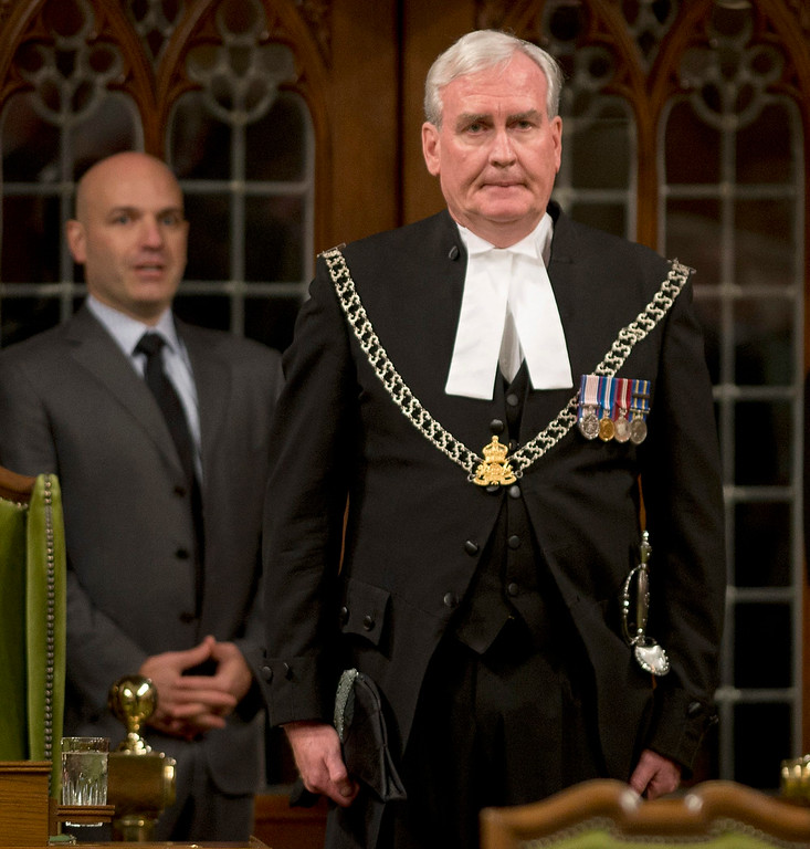 . Sergeant at Arms for the House of Commons Kevin Vickers reacts to a long standing ovation in the House of Commons Thursday Oct. 23, 2014 in Ottawa. Vickers was among those who opened fire on Michael Zehaf Bibeau, who stormed Parliament Hill on Wednesday. (AP Photo/The Canadian Press, Adrian Wyld)