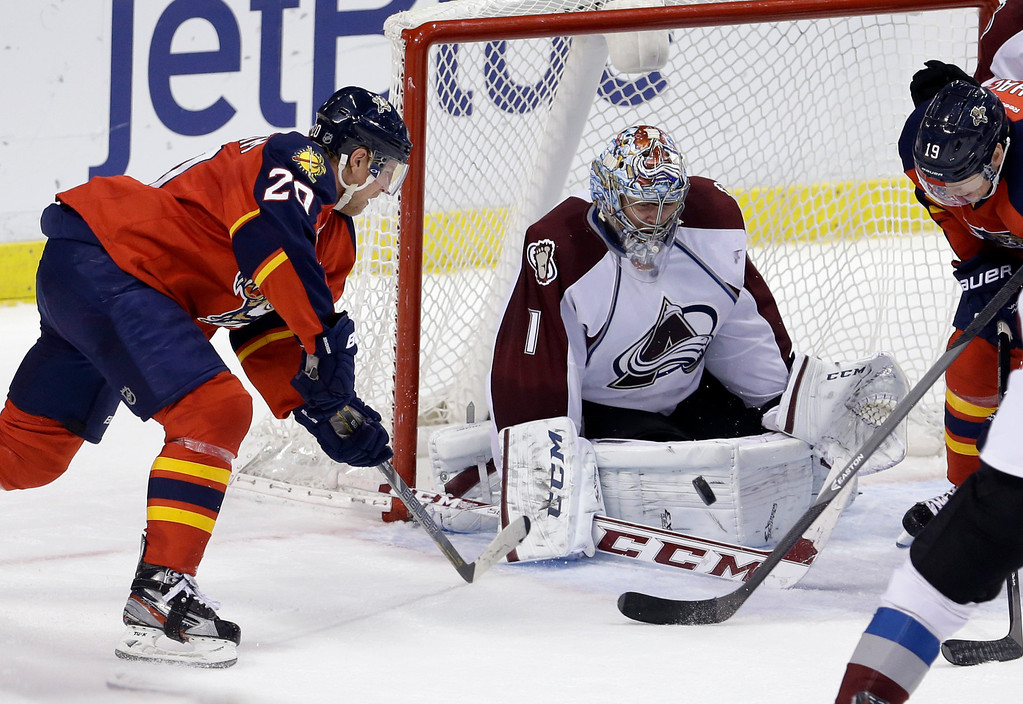 . Colorado Avalanche goalie Semyon Varlamov (1) stops a shot by Florida Panthers left wing Sean Bergenheim (20) during the third period of an NHL hockey game in Sunrise, Fla., Friday, Jan. 24, 2014. The Avalanche won 3-2. (AP Photo/Alan Diaz)