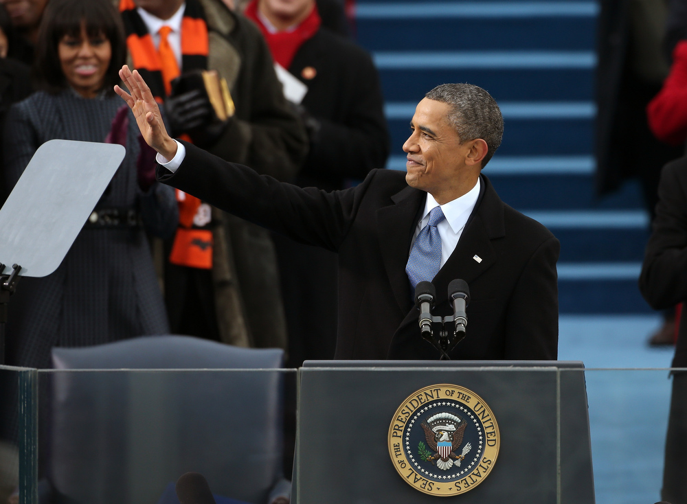 . U.S. President Barack Obama waves before speaking during the presidential inauguration on the West Front of the U.S. Capitol January 21, 2013 in Washington, DC.   Barack Obama was re-elected for a second term as President of the United States.  (Photo by Justin Sullivan/Getty Images)