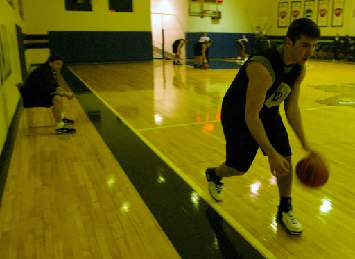 . Oakland University men\'s basketball player Brandon Cassise, right, practices dribbling under the watchful eye of head coach Greg Kampe, during practice held at the Mabee Center, on the campus of Oral Roberts University in Tulsa, OK, Friday, March 2, 2007.  (The Oakland Press/Jose Juarez)