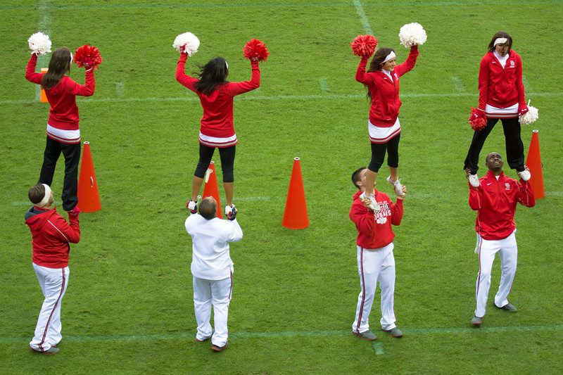 Four Cheerleaders held up by four more cheerleaders ...