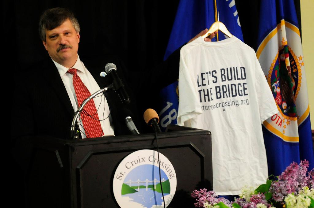 . Stillwater Mayor Ken Harycki displays a bridge T-shirt at the groundbreaking ceremony.  (Pioneer Press: Scott Takushi)