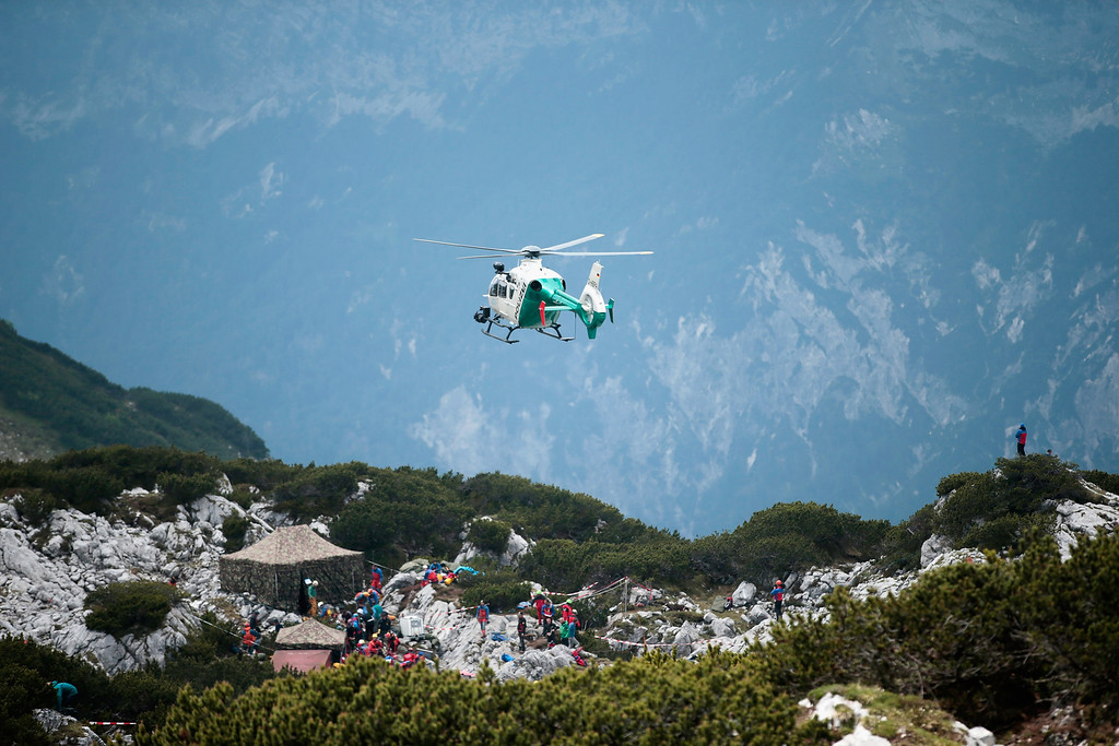 . Rescue workers wait for the touch down of an helicopter near the entrance to the Riesending vertical cave after the final phase of the transport of injured spelunker Johann Westhauser to the surface on June 19, 2014 near Marktschellenberg, Germany.  (Photo by Johannes Simon/Getty Images)
