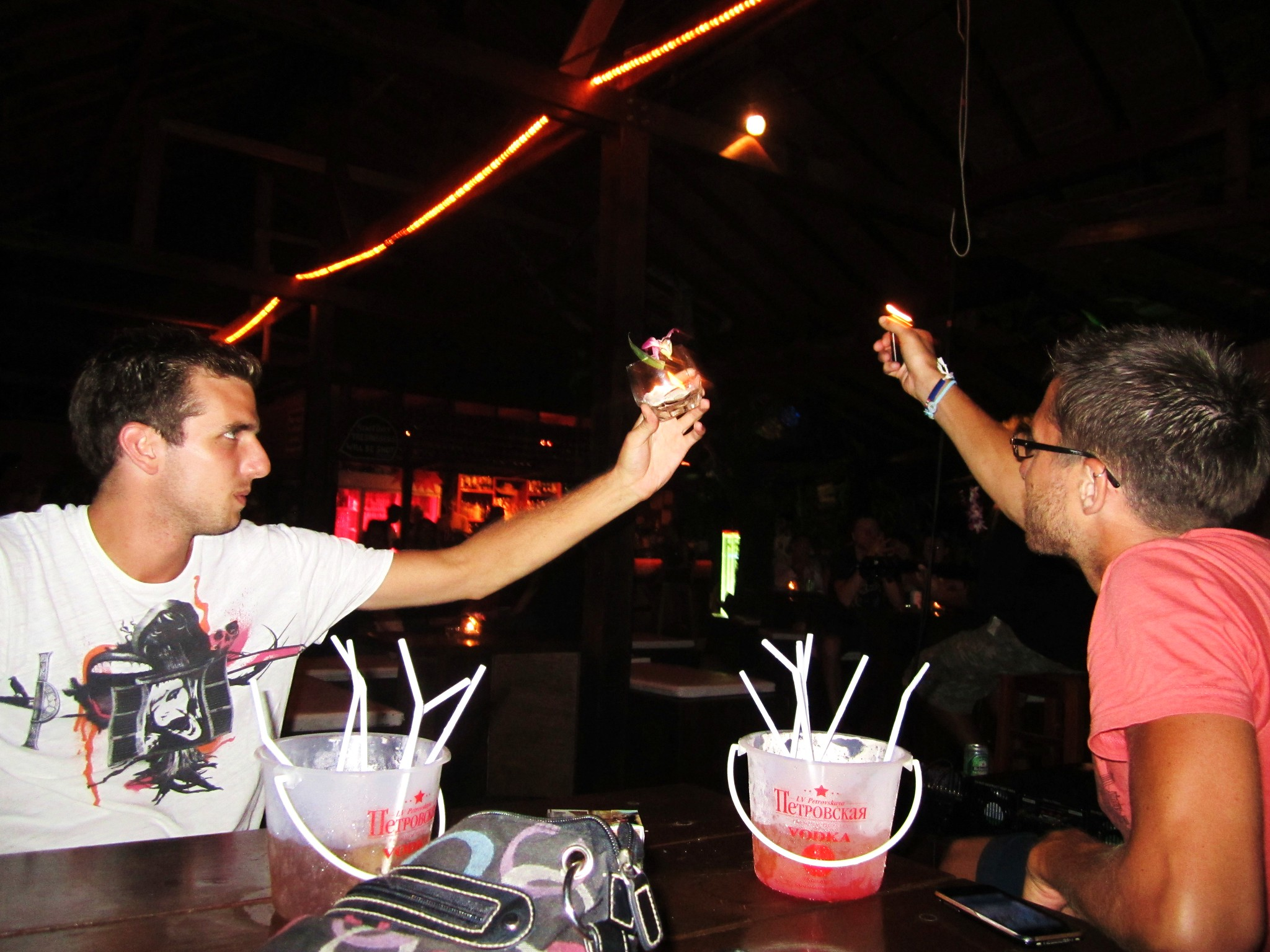 Drinking cocktails and holding up flames to the band in Koh Phi Phi.