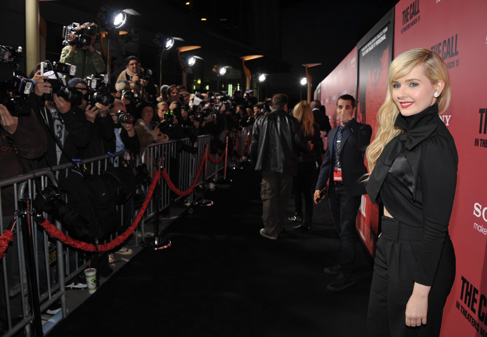 """. Actress Abigail Breslin arrives at world premiere of \""""The Call\"""" at the Arclight Hollywood on Tuesday, March 5, 2013 in Los Angeles. (Photo by John Shearer/Invision/AP)"""