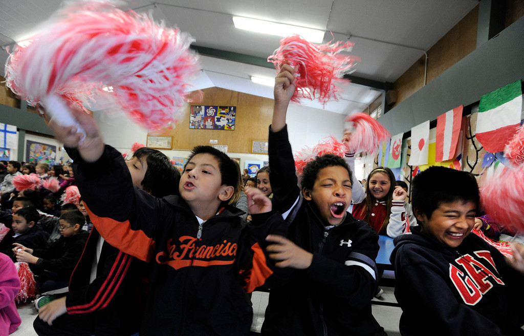 ". Demonstrating their human motion energy and their ability to make wind, third-graders from left, Gabriel David, Rick Camacho and Joseph Juarez Aguilar jump up and down and wave their pom poms for the red team during a ""Science Rocks\"" program at El Monte Elementary School in Concord, Calif., on Tuesday, Feb. 26, 2013. (Susan Tripp Pollard/Staff)"