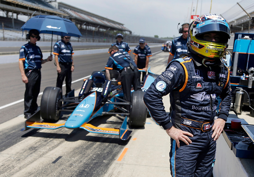 . Alex Tagliani, of Canada, waits for his crew to ready his car during practice for the Indianapolis 500 auto race at the Indianapolis Motor Speedway in Indianapolis, Wednesday, May 15, 2013. (AP Photo/Michael Conroy)