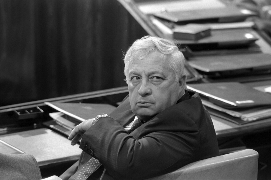 . In this handout from the Israeli Governmental Press Office, Industry and Trade Minister Ariel Sharon sits in his chair in the Knesset, the Israeli parliament, May 6, 1985 in Jerusalem. (Photo by Nati Harnik/GPO via Getty Images)
