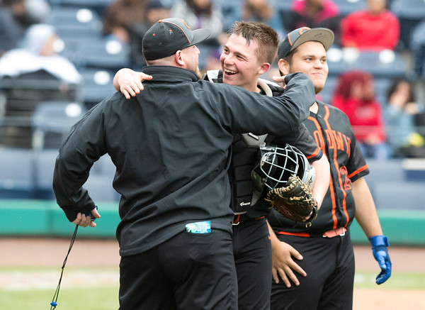 05/01/19 Wesley Bunnell | Staff Goodwin Tech baseball was defeated by Prince Tech on Wednesday evening at Dunkin Donuts Park in Hartford.Michael Lukaszewski (10) smiles after an easy inning for Goodwin in the field.
